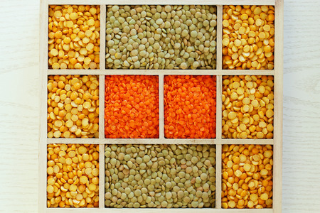 compartments: Selection of lentils in wooden compartments