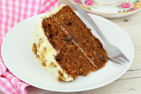carrot cakes: Carrot cake with walnuts and marzipan icing Stock Photo