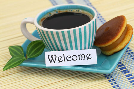welcome mat: Welcome card with cup of coffee and cookie Stock Photo