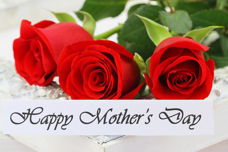 three wishes: Happy Mothers day card with red roses Stock Photo