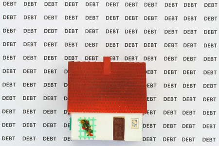 repayment: House on background with words debt