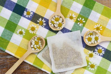 chamomile tea: Fresh chamomile flowers and chamomile tea bag Stock Photo