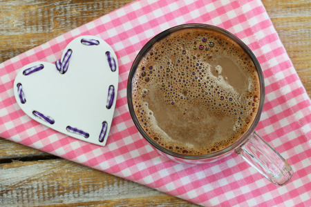 woodenrn: Hot chocolate in glass on pink checkered cloth and white heart Stock Photo