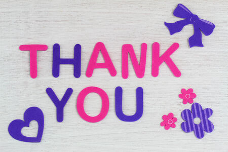 woodenrn: Thank you written with colorful letters on white wood