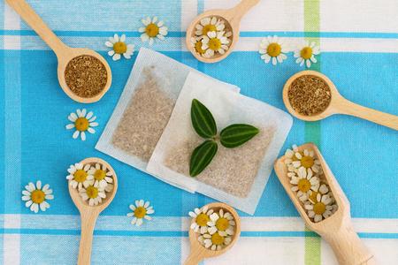 chamomile tea: Fresh and dried chamomile flowers and chamomile tea bags Stock Photo