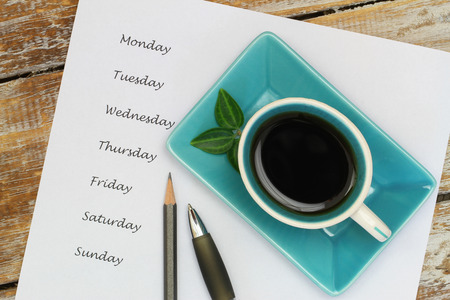 weekdays: Coffee and weekdays listed on white piece of paper