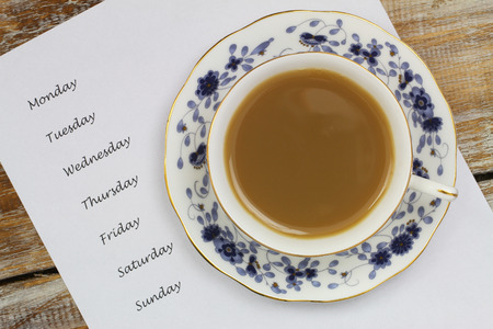 weekdays: Cup of tea with weekdays listed on white paper Stock Photo