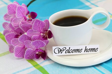 welcome home: Welcome home card with cup of coffee and pink orchid