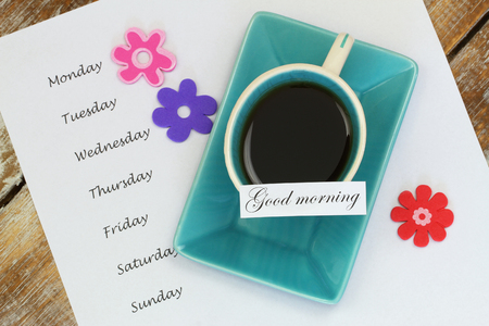 good morning: Good morning card with cup of tea and days of the week listed on white paper