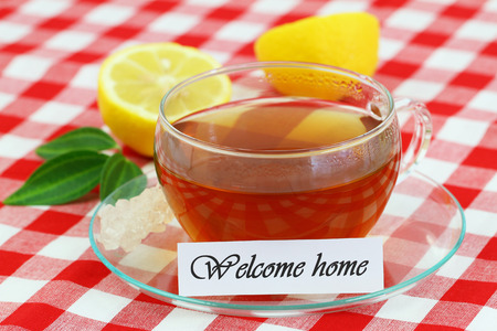 welcome home: Welcome home card with cup of tea and lemon Stock Photo