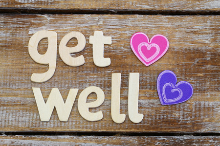 get well: Get well written with wooden letters on rustic wooden surface