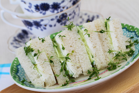 english cucumber: Cream cheese and cucumber sandwiches, closeup Stock Photo