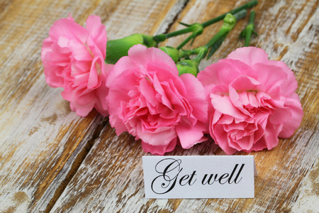 get well: Get well card with pink carnation flowers Stock Photo