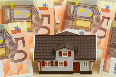 repayment: House with Euro banknotes