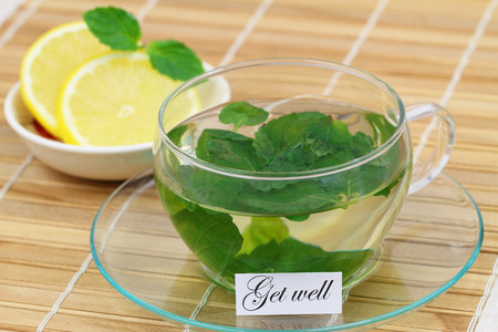 get well: Get well card with cup of mint tea and lemon Stock Photo