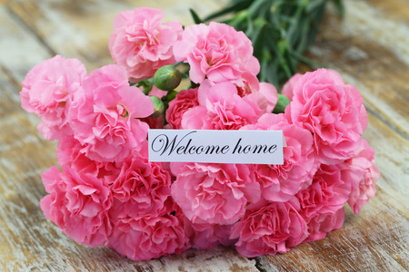 welcome home: Welcome home card with pink carnations