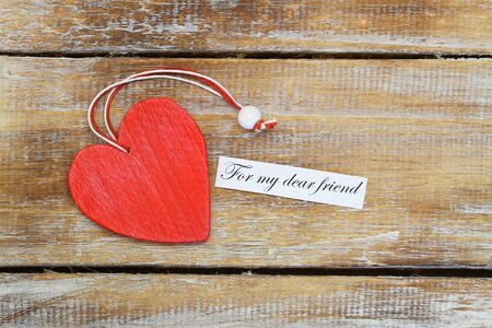 my dear: For my dear friend card with red wooden heart on rustic wood Stock Photo