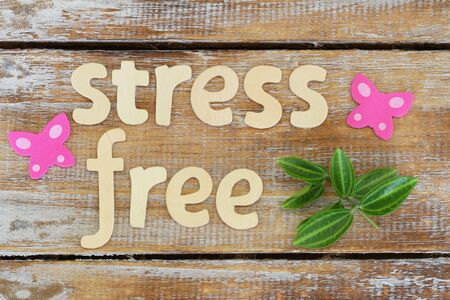 Stress free written with wooden letters on rustic surface