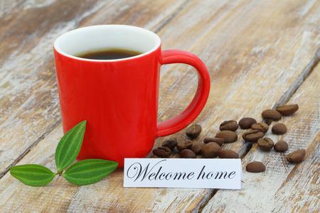 welcome home: Welcome home card with mug of coffee Stock Photo