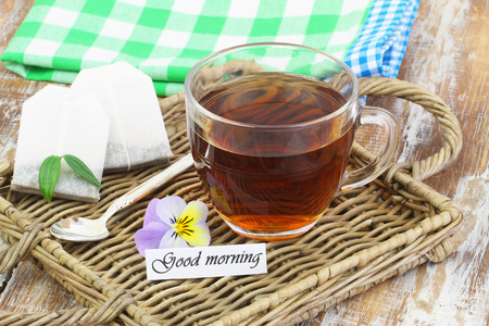 Good morning card with cup of tea on wicker tray Zdjęcie Seryjne