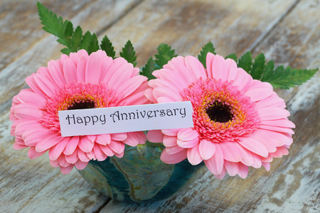 gerbera daisies: Happy Anniversary card with pink gerbera daisies Stock Photo
