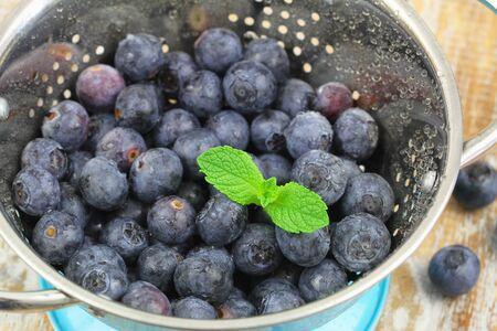 colander: Blueberries in colander, closeup Stock Photo