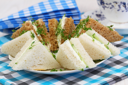 english cucumber: Cream cheese and cucumber sandwiches and stack or checkered napkins