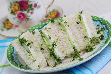 english cucumber: White cream cheese and cucumber sandwiches with watercress Stock Photo