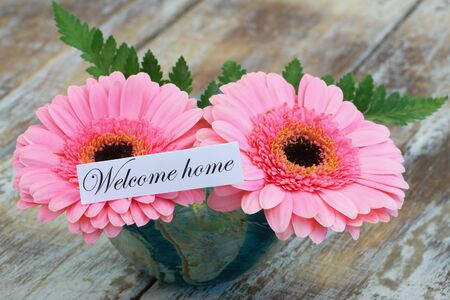 gerbera daisies: Welcome home card with pink gerbera daisies
