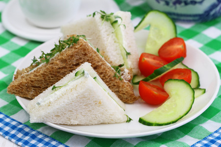 english cucumber: Cream cheese and cucumber sandwiches with green salad