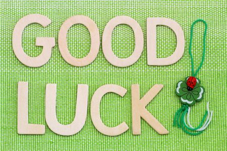 lucky clover lucky: Good luck written with wooden letters and four-leaf clover Stock Photo