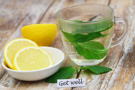 get well: Get well card with glass of mint tea and lemon Stock Photo