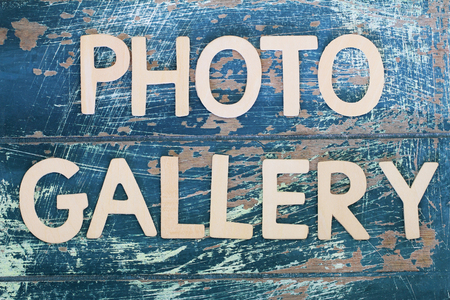dated: Photo gallery written on rustic wooden surface Stock Photo