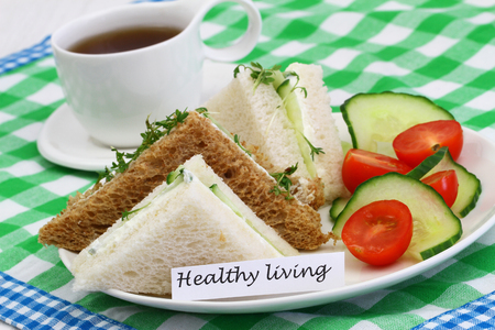 english cucumber: Healthy living card with cream cheese sandwiches and green salad