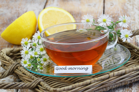 trays: Good morning card with chamomile tea on wicker tray Stock Photo