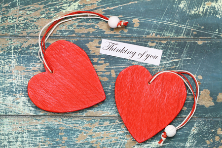 thinking of you: Thinking of you card with two red wooden hearts
