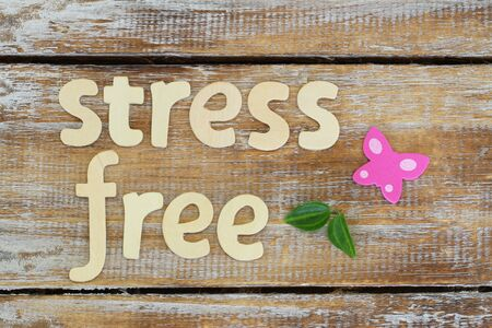 Stress free written with wooden letters on rustic surface Stock Photo