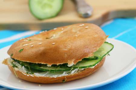 Bagel with cream cheese and cucumber