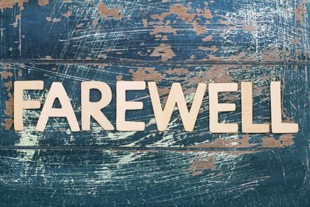 farewell: Word farewell written on rustic wooden surface