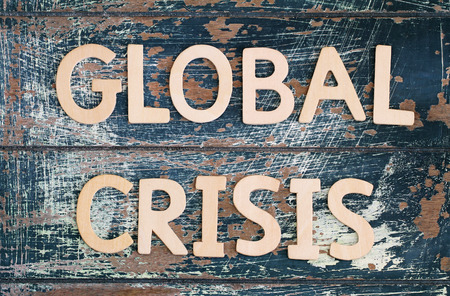 global crisis: Global crisis written on rustic wooden surface