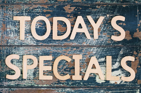 specials: Todays specials written on rustic wooden surface