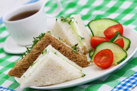 side salad: White and brown cream cheese sandwiches with green side salad Stock Photo