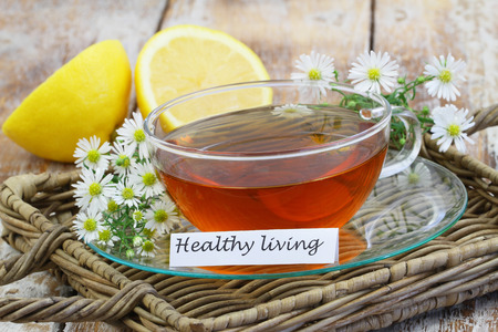chamomile tea: Healthy living card with cup of chamomile tea Stock Photo