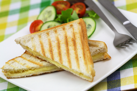 side salad: Toasted bread with melted cheese and green side salad Stock Photo