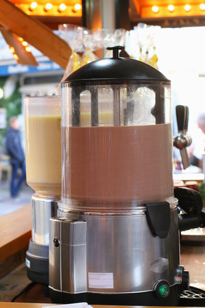 eggnog: Chocolate punch and eggnog in dispensers