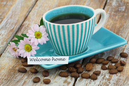 welcome home: Welcome home card with cup of coffee and pink daisy flowers Stock Photo