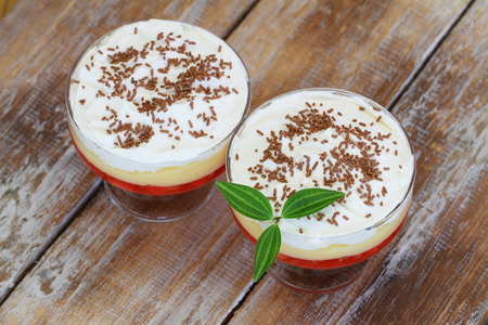 trifle: Traditional English trifle dessert on rustic wooden surface Stock Photo