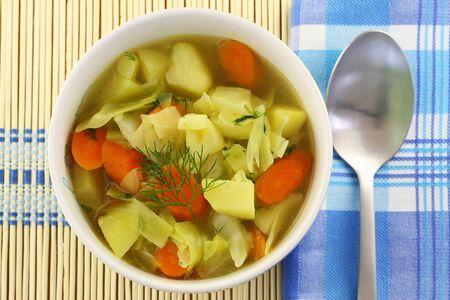 potato soup: Bowl of cabbage soup on bamboo mat
