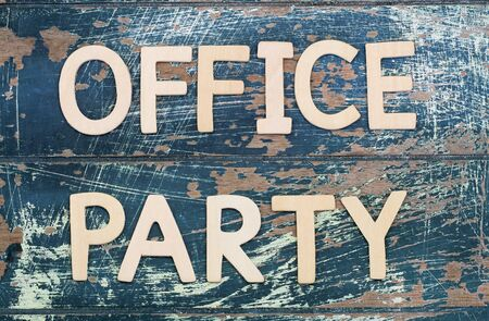 office party: Office party written with wooden letters on rustic surface