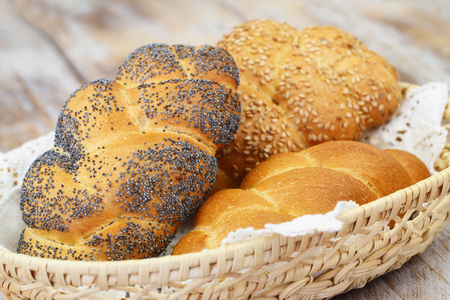 breadbasket: Challah bread with poppy seeds, sesame seeds and plain in breadbasket